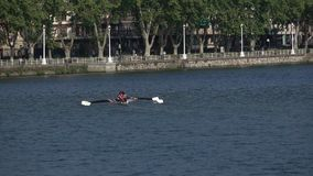 Rowing crew during practice. A view of people rowing in a river stock footage