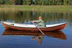 Rowing de la mujer Imagenes de archivo