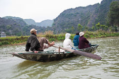 Rowing with feet, at Tam coc, vietnam Stock Image
