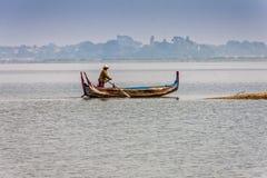 A rowing fisherman on Taung Tha Man Lake, Amarapura, Myanmar royalty free stock image