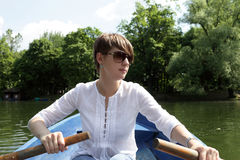 Rowing girl in a boat Royalty Free Stock Image