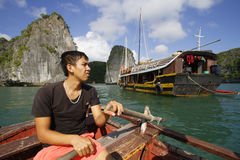 Rowing in Ha Long Bay Stock Photography
