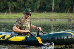 Free Rowing In Inflatable Boat Royalty Free Stock Photography - 128865047