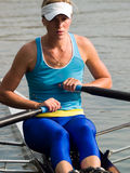 Rowing Lady. Sporty young lady rowing in boat on water Stock Photos
