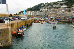 Rowing at Mousehole Harbour Stock Photos