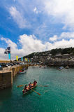 Rowing at Mousehole Harbour Stock Images