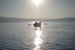 Rowing a small boat Stock Photo