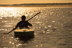 Rowing at sunset Stock Photo