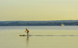 Rowing at sunset on Ammersee Lake Royalty Free Stock Photo