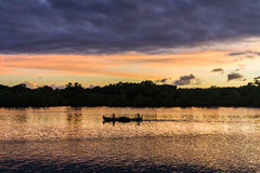 Rowing at sunset Stock Photography