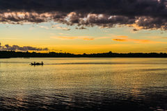 Rowing at sunset Stock Images