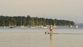 Rowing at sunset Stock Photos