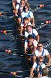 Rowing Team. Junior rowing team rowing ahead during a boat-race on the River Vltava in Prague, Czech Republic Stock Images