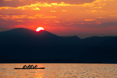 Rowing team at sunset. Stock Images
