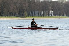 Rowing training - rower on the boat. St. Petersburg, Russia - April 26, 2019: young man rowing a single scull. rowing training on the Malaya Nevka river stock photography