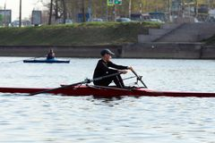 Rowing training - rower on the boat stock images