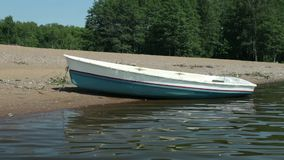 Rowingboat moored at shore stock footage