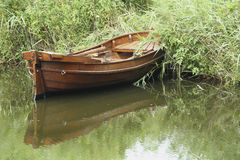 Rowingboat at the waterside Royalty Free Stock Photo