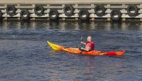Rowman rowing a kayak Stock Photos