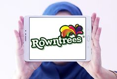Rowntree`s food brand logo. Logo of Rowntree`s food on samsung tablet holded by arab muslim woman. Rowntree is an English confectionery business stock photos