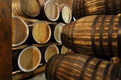Rows of alcoholic barrels are kept in stock. Distillery. Cognac, whiskey, wine, brandy. Alcohol in barrels, alcohol. Rows of alcoholic barrels are kept in stock stock image