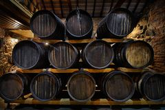 Rows of alcoholic drums in stock. Distillery. Cognac, whiskey, wine, brandy. Alcohol in barrels. Rows of alcoholic drums in stock. Distillery. Cognac, whiskey stock photo