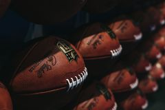 Rows of american football balls in NFL Experience in Times Square, New York royalty free stock photos