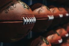 Rows of american football balls in NFL Experience in Times Square, New York royalty free stock photography