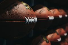 Rows of american football balls in NFL Experience in Times Square, New York, USA royalty free stock photos