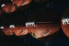 Rows of american football balls in NFL Experience in Times Square, New York, USA stock photography