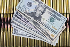 Rows of ammo with American money on top. Rows of rifle ammo touching USD Stock Photography