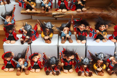 Rows of amusing toy vikings with flags of Norway Royalty Free Stock Image