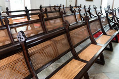 Rows of Antique, Handcrafted Pews in an Old Church Royalty Free Stock Image