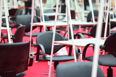 Rows of armchairs, tables and mirrors Royalty Free Stock Image