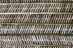 Rows of arranged bricks on a wood shelf. Royalty Free Stock Image