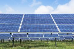 Rows array of solar cells or photovoltaics in solar power station. Alternative clean renewable energy stock photos