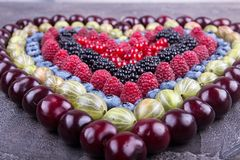 Rows of assorted fruits and berries: sweet cherry, bluberries, raspberries, red and black currant, blackberries. Helthy eating royalty free stock photo