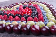 Rows of assorted fruits and berries: sweet cherry, bluberries, r royalty free stock image