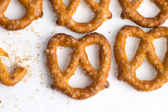 Rows of baked pretzels on white. Rows of baked pretzels on white stock photo
