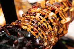 Rows of Baltic amber necklaces and bracelets stock images