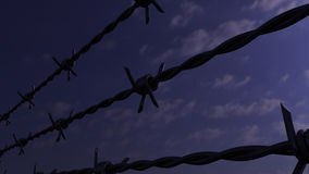 Rows of barbed wires against evening cloudy sky, 3D rendering. Rows of barbed wire against evening cloudy sky Stock Images