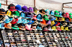 Rows of baseball caps and sunglasses on Whitby market stall Royalty Free Stock Image