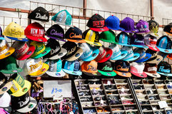 Rows of baseball caps and sunglasses on Whitby market stall Royalty Free Stock Photography