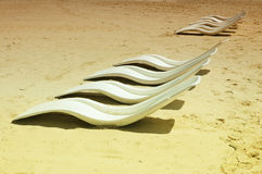 Rows of beach chairs Stock Photos