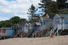 Rows of beach huts lining the beach in Norfolk Royalty Free Stock Photography