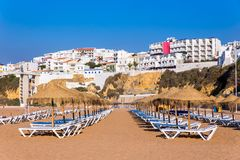 Rows of beach parasols with buildings Stock Photography