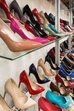 Rows of beautiful women's shoes on store shelves Royalty Free Stock Image