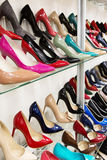 Rows of beautiful women's shoes on store shelves Stock Image