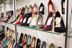 Rows of beautiful women's shoes on store shelves Royalty Free Stock Photo