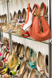 Rows of beautiful women's shoes on store shelves Royalty Free Stock Photography